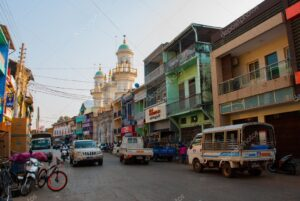 The main street of Mawlamyaing with the mosque in the background